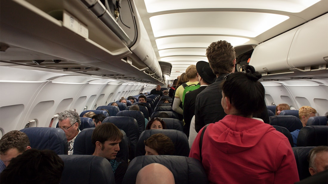 4 Ways to Make Your Flight in Coach More Comfortable